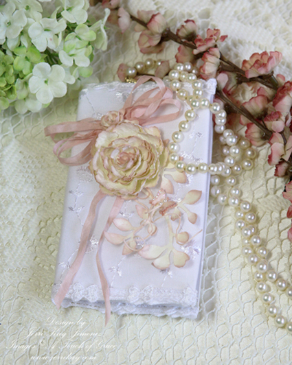 the brideu0027s bible is covered with a linen and lace trimmed book cover that i altered to match the bridal series i dyed 18u2033 white ribbon using the soft